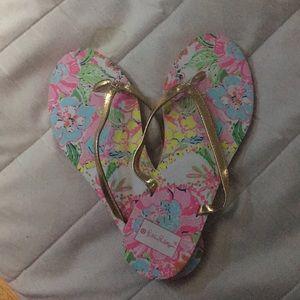 Lilly Pulitzer flip flops.